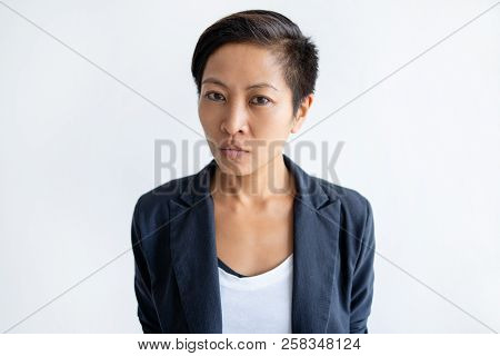 Serious Asian Business Woman Looking At Camera. Young Lady. Contemplation Concept. Isolated View On