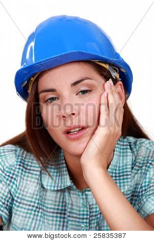A tired-looking tradeswoman