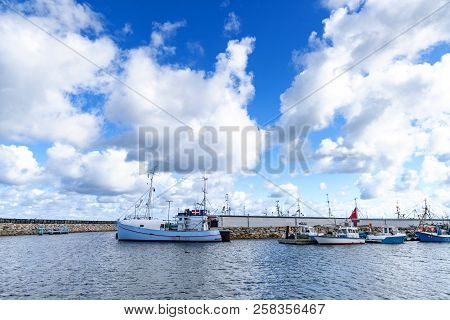 Fishing Boats In A Harbor In Denmark Under A Blue Sky In The Summer
