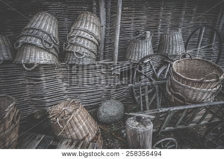 Weave Baskets Workshop Stacked In A Wooden Cabin With Old Wheels And Ladders