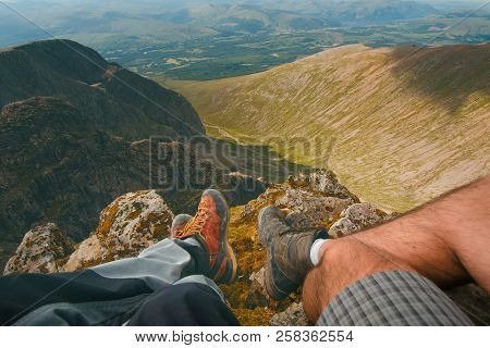Man Hiker Sitting On The Top Of Mountain Rocks. Beautiful Weather With Scotland Nature. Detail Of Hi