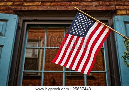 This Is A Us Flag As Seen From The Street As It Hangs From A Lamp Post In Philadelphia, Pa.