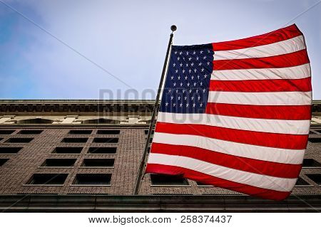 This Is A Us Flag As Seen From The Street As It Hangs From A Building In Philadelphia, Pa.