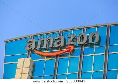 Sunnyvale, California, Usa - August 13, 2018: Closeup Of Amazon Sign Atop Of Glass Building Of Big A