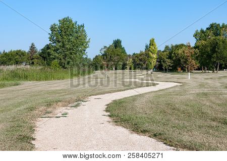 Winding Gravel Path Through Green Prairie Parkland