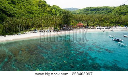Aerial view of the Crsytal bay beach and underwater reef in the Nusa Penida island, near Bali, Indonesia