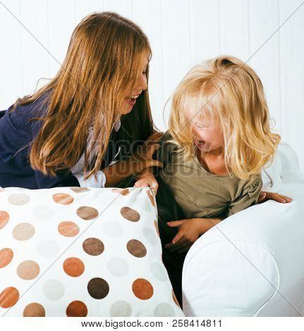 Two Cute Sisters At Home Playing, Little Girl In House Interior