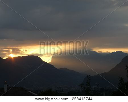 Sunrise Over A Summit Rock In The Mountains Of South Tyrol Italy Europe With Red Sky