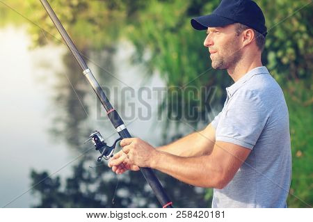 Fishing In Lake. Fisherman With Fishing Rod. Portrait Of Fisherman. Active Outdoor Activities. Hobby