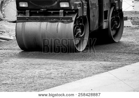 Road Construction Site In Berlin, Germany: Steamroller At Asphalt Pavement Works, Black And White