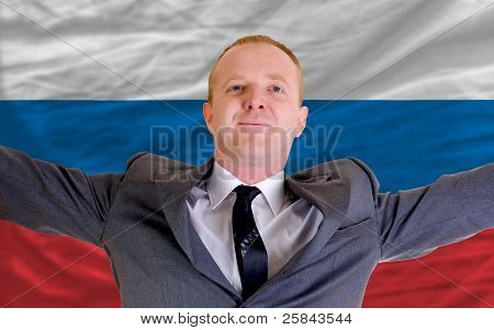 Happy Businessman Because Of Profitable Investment In Russia Standing Near Flag