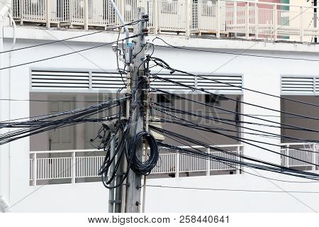Electricity Pole And Complicated Wiring On The Pole