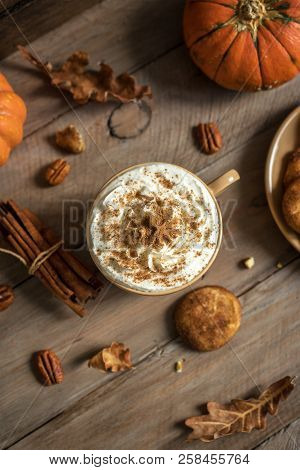 Pumpkin Spice Latte. Cup Of Latte With Seasonal Autumn Spices, Cookies And Fall Decor. Traditional C