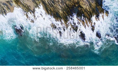 Aerial View Of Waves Crashing On Rocks,seascape With Birds Eye View Shot Over Ocean Waves Image For