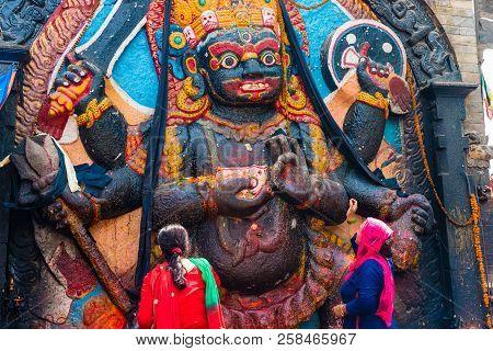 Statue And Shrine Of Kal Bhairav At Kathmandu Durbar Square, Kathmandu Valley, Nepal
