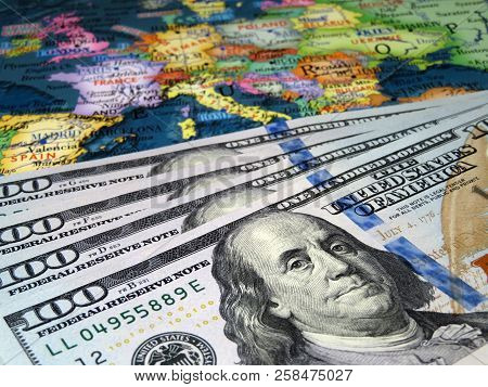 Us Dollars On The Europe Map Background. Concept For Trade Between The United States And Europe, Ame