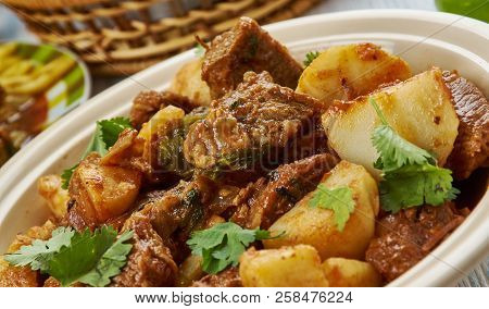 Serbian Goulash-Paprikash, Balkan cuisine cuisine, Traditional assorted dishes, Top view.ade with onions, olive oil, lamb, bay leaves, tomato paste, water, paprika, red chile. poster