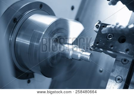 The  Cnc Lathe Machine Or Turning Machine  Cutting The Thread At The Steel Shaft.the Threading Proce