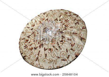 Round cloth with beadwork