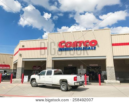 Truck Driving By Costco Wholesale Entrance Storefront
