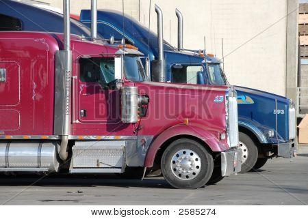 Two Trucks At Warehouse