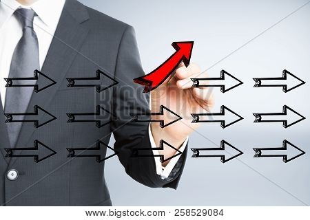 Businessman Hand Drawing Different Arrows On Light Background. Leadership, Different Direction And S