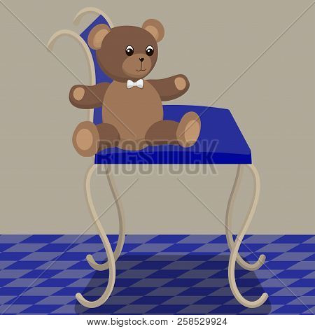 Toy Teddy Bear Sits On A Chair