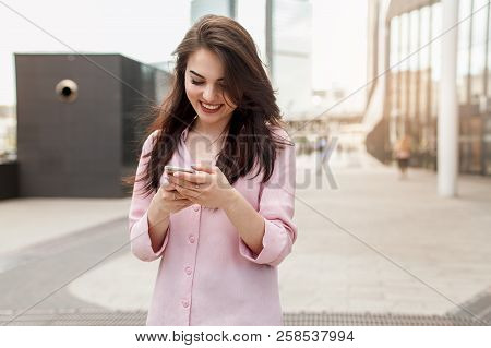 Happy Pretty Brunette Girl Business Woman Using Mobile Phone, Beautiful Woman Browsing Phone And Doi