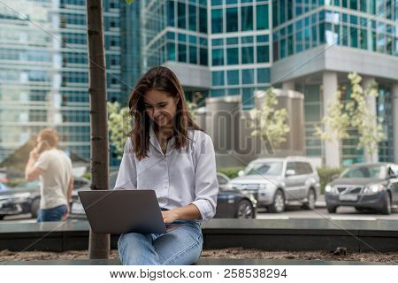 Young Business Woman Using Laptop For Work, Beautiful Busy Woman Typing On Portable Computer For Dis