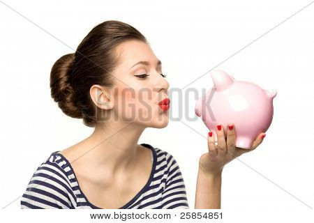 Pin-up girl kissing piggy-bank