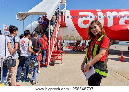 PATTAYA, THAILAND - FEBRUARY 26, 2016: ground crew member at U-Tapao International Airport.