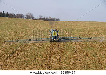 Tractor spraying pn field