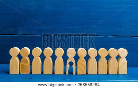 The Wooden Figure Of People With A Void Inside The Body In The Form Of A Child Stands In Line With O