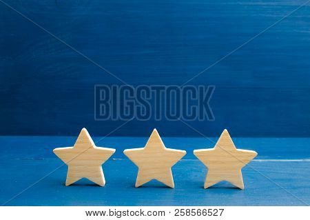The Rating Of The Hotel, Restaurant, Mobile Application. Three Stars On A Blue Background. The Conce