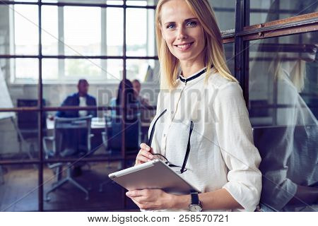 Leading Her Team To Success. Confident Young Woman Holding Digital Tablet And Looking At Camera With