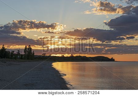 Sunset on a Remote Beach on DH Day Beach in Sleeping Bear Dunes National Lakeshore in Michigan poster