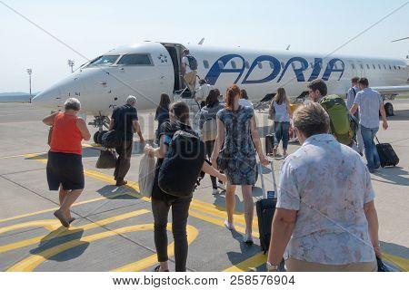 Ljubljana, Slovenia - August 25 2018: Passengers Board Adria Airways Bombardier Crj-900 Passenger Je
