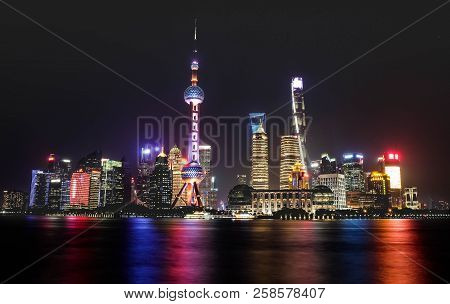 Shanghai, China - Jun 21 , 2018:a Night View Of The Modern Pudong Skyline Across The Bund In Shangha