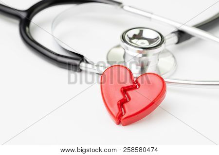 Heart Attact Or Broken Heart Concept, Cute Read Heart Break With Medical Stethoscope On White Backgr