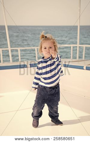 Adorable Cute Little Baby Captain On Boat Or Sailing Yacht On Summer Cruise. Travel Adventure, Yacht