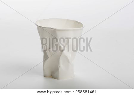 Crumbled White Paper Coffee Cup On White Background.