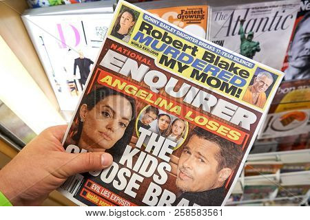 Miami, Usa - August 22, 2018: The National Enquirer Newspaper In A Hand. The National Enquirer Is A