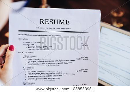 Woman Holding Resume Application With Using Tablet Digital To Job Search On Internet. Applying For A
