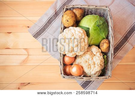 Basket With Different Fresh Farm Vegetables. Top View With Copy Cpace.