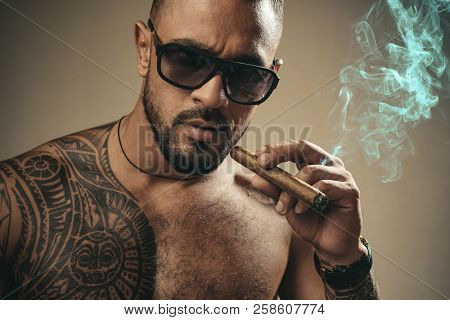 Muscular Athletic Sexy Male With Naked Torso. Brutal Handsome Man With Tattooed Body. Stylish Bearde