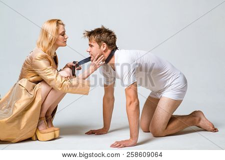Domination And Submission. Woman And Man Playing Domination Games. Dominate Obey Undress Seduce A Pa