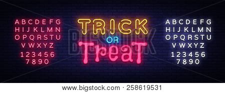 Trick Or Treat Neon Text Vector Design Template. Trick Or Treat Neon Logo, Light Banner Design Eleme