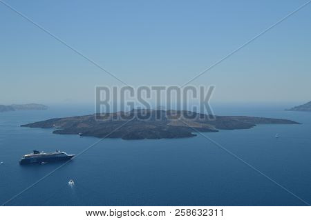 Views Of The Thera Bay From Fira With A Moored Cruise On It And The Beautiful View Of The Island Tha