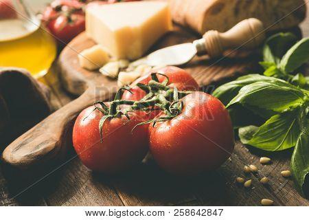 Tomatoes On Vine, Parmesan Cheese, Olive Oil, Basil And Ciabatta Bread. Italian Cuisine Food Ingredi