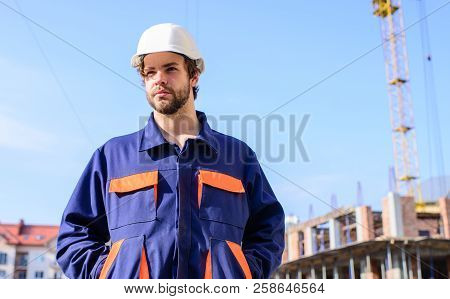 Control Construction Process. Builder In Working Clothes And Helmet Works Construction Site. Crane C
